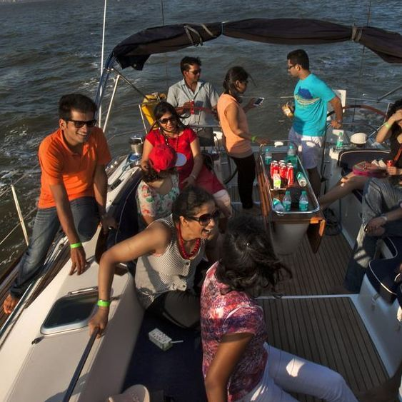 In this photo provided by Floh, single Indians mingle on a sunset cruise organized by the social networking service.