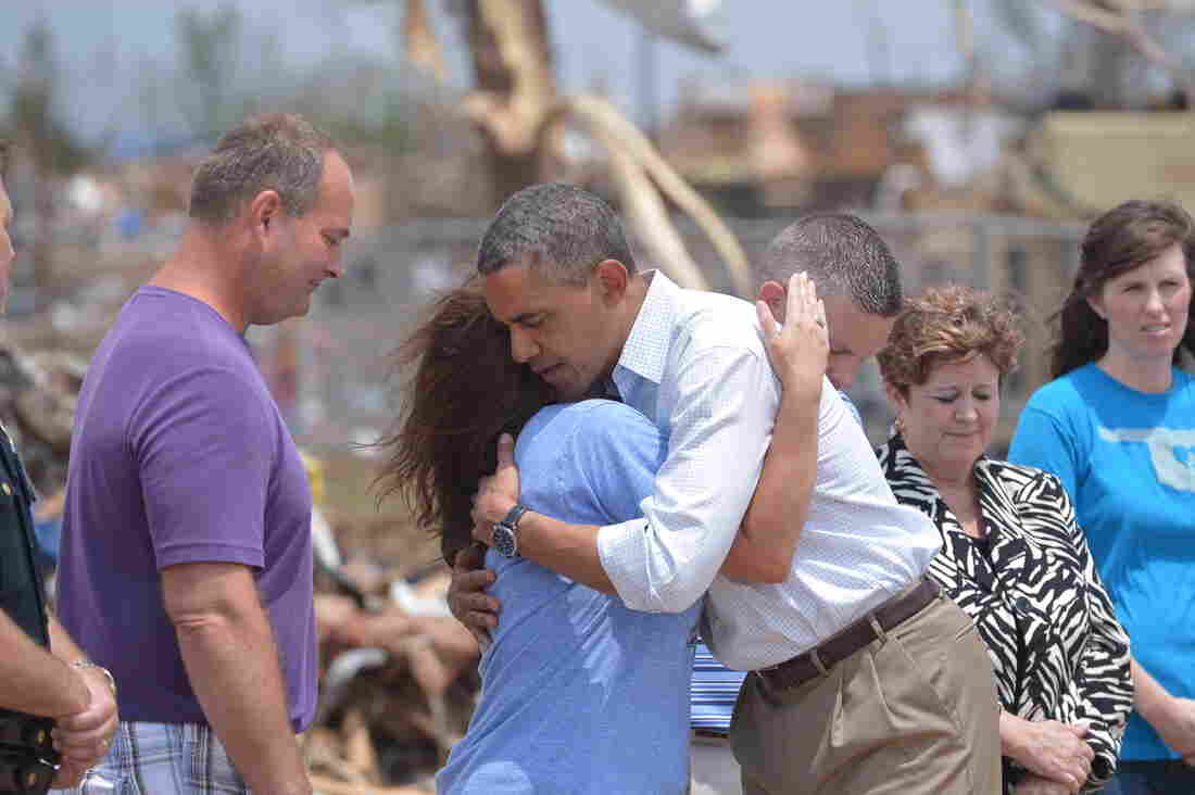 President Obama is greeted as he tours a tornado affected area on Sunday in Moore, Oklahoma.
