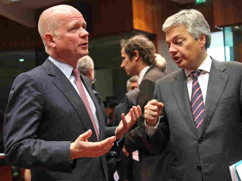British Foreign Secretary William Hague (left) talks with Belgium's foreign minister, Didier Reynders, during a European Union foreign ministers meeting in Brussels on Monday.