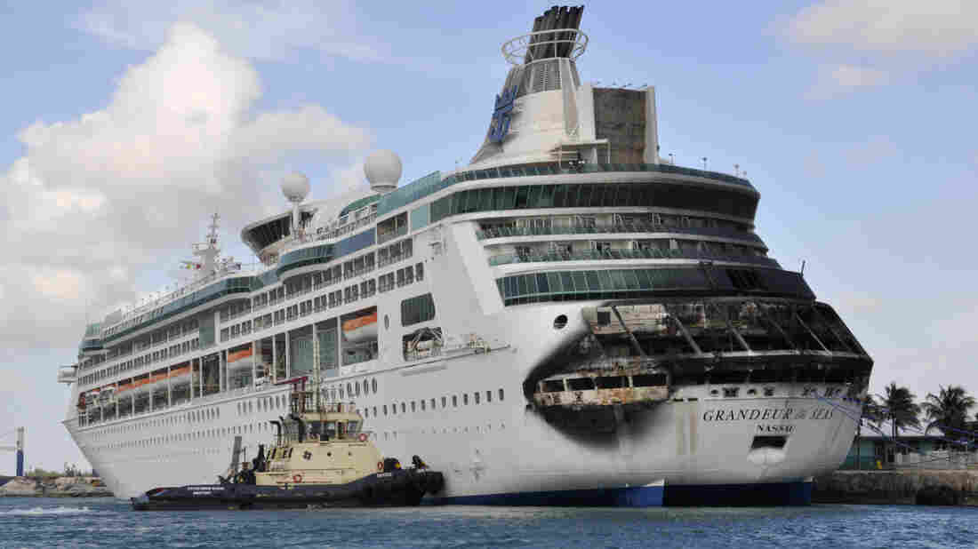 Damage on the Royal Caribbean ship Grandeur of the Seas is visible as the ship docks in Freeport, the Bahamas, on Monday.