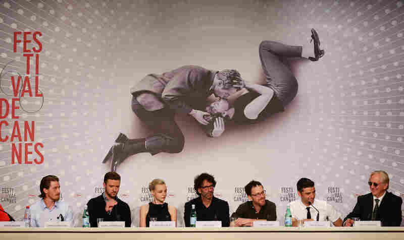 Actors Garrett Hedlund (from left), Justin Timberlake, Carey Mulligan, directors Joel and Ethan Coen, Oscar Isaac and T-Bone Burnett attend the Inside Llewyn Davis press conference at the Cannes Film Festival on May 19.