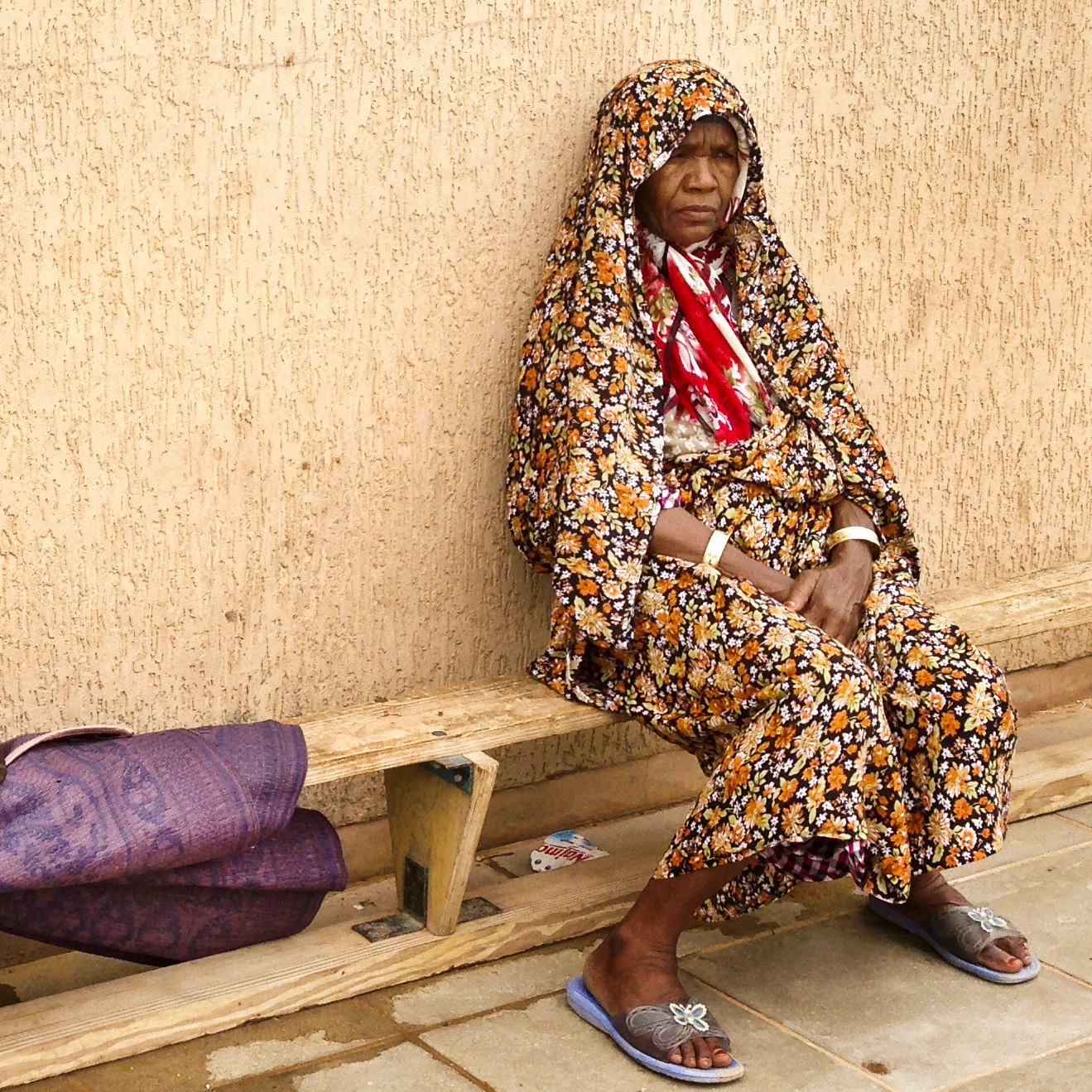 A Tawarghan woman sits outside at a makeshift camp where thousands of displaced Tawarghans live after being driven from their homes by Misratan militiamen.