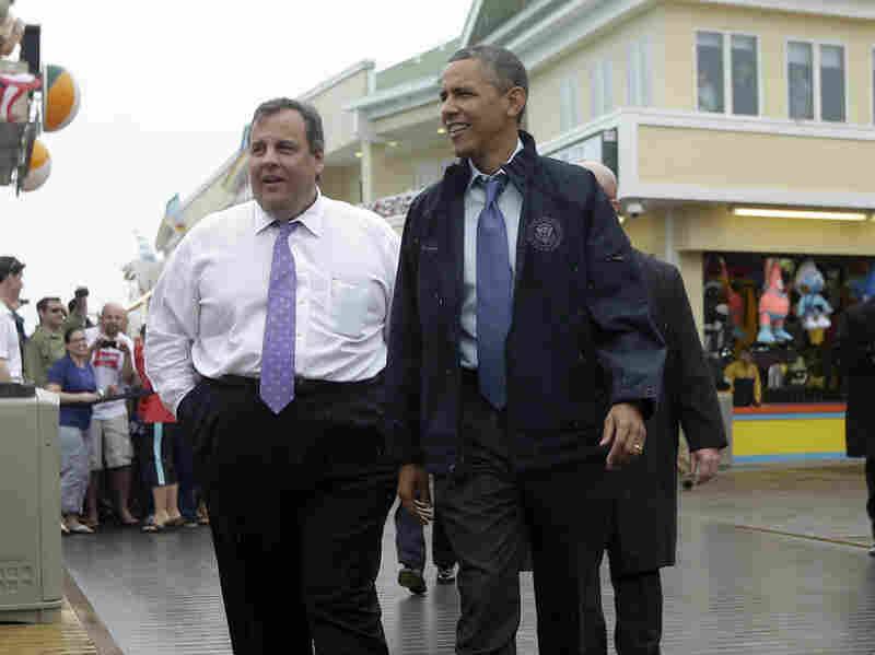 President Obama and New Jersey Gov. Chris Christie walk along the boardwalk in Point Pleasant, N.J., on Tuesday. Obama traveled to New Jersey to join Christie in touring the Jersey Shore and inspecting its recovery efforts from Superstorm Sandy.
