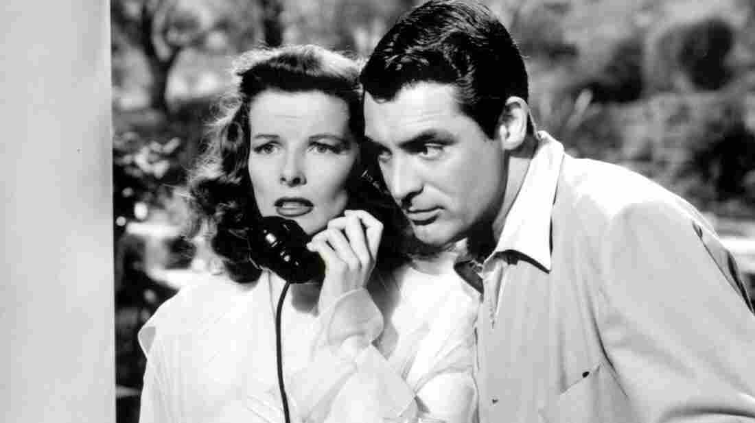 Katharine Hepburn and Cary Grant in The Philadelphia Story, in which Cary Grant is very charming.