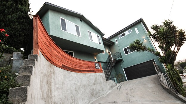 This home in the Glassell Park neighborhood of Los Angeles was bought by Dossier Capital for $390,000, records show. It's now listed for more than $720,000. (Courtesy of Dossier Capital)
