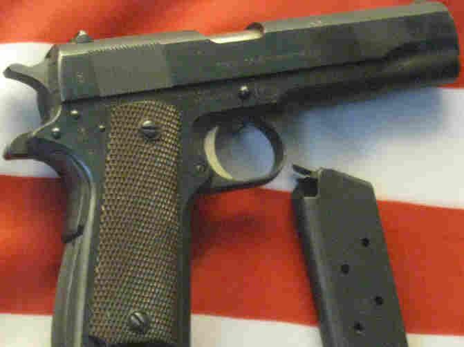 Handgun on flag.