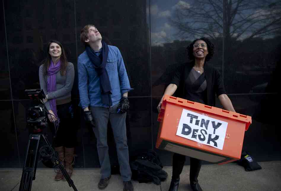 Off camera, All Things Considered Host Audie Cornish (far right) carries the Tiny Desk moving crate. Look for Cornish's and other NPR host and reporter cameos throughout the video.