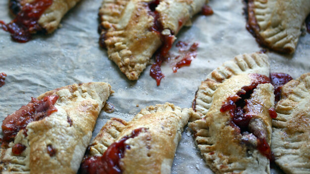 Strawberry-Rhubarb Hand Pies on parchment