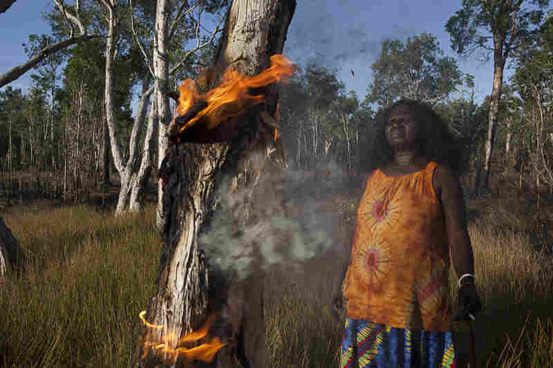"""Batumbil Burarrwanga manages her homelands with fire. """"Fire is my totem. I am fire. It is deep down inside me. Fire is my talent, my voice. When I talk, my voice is the flame; through the flame is my power."""""""