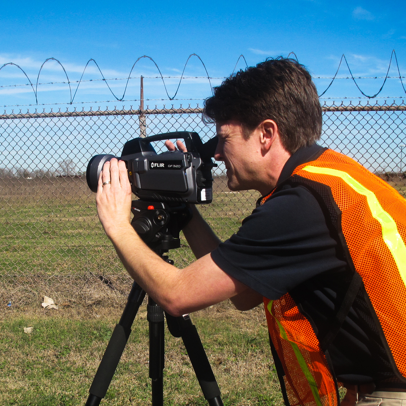 Jason Harris, with the Texas Commission for Environmental Quality, uses an infrared camera to find leaks at a chemical facility near the Houston Ship Channel. The specialty cameras cost around $100,000.