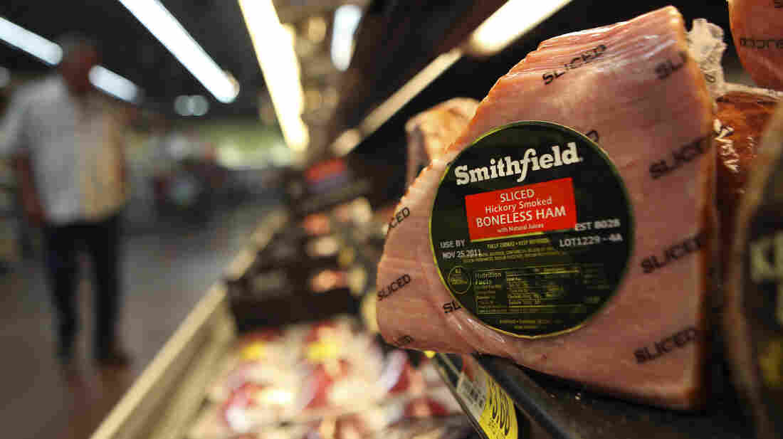 Smithfield Foods, makers of ham products under a variety of brand names, is being purchased by Chinese food maker Shuanghui International, for $4.72 billion in cash.