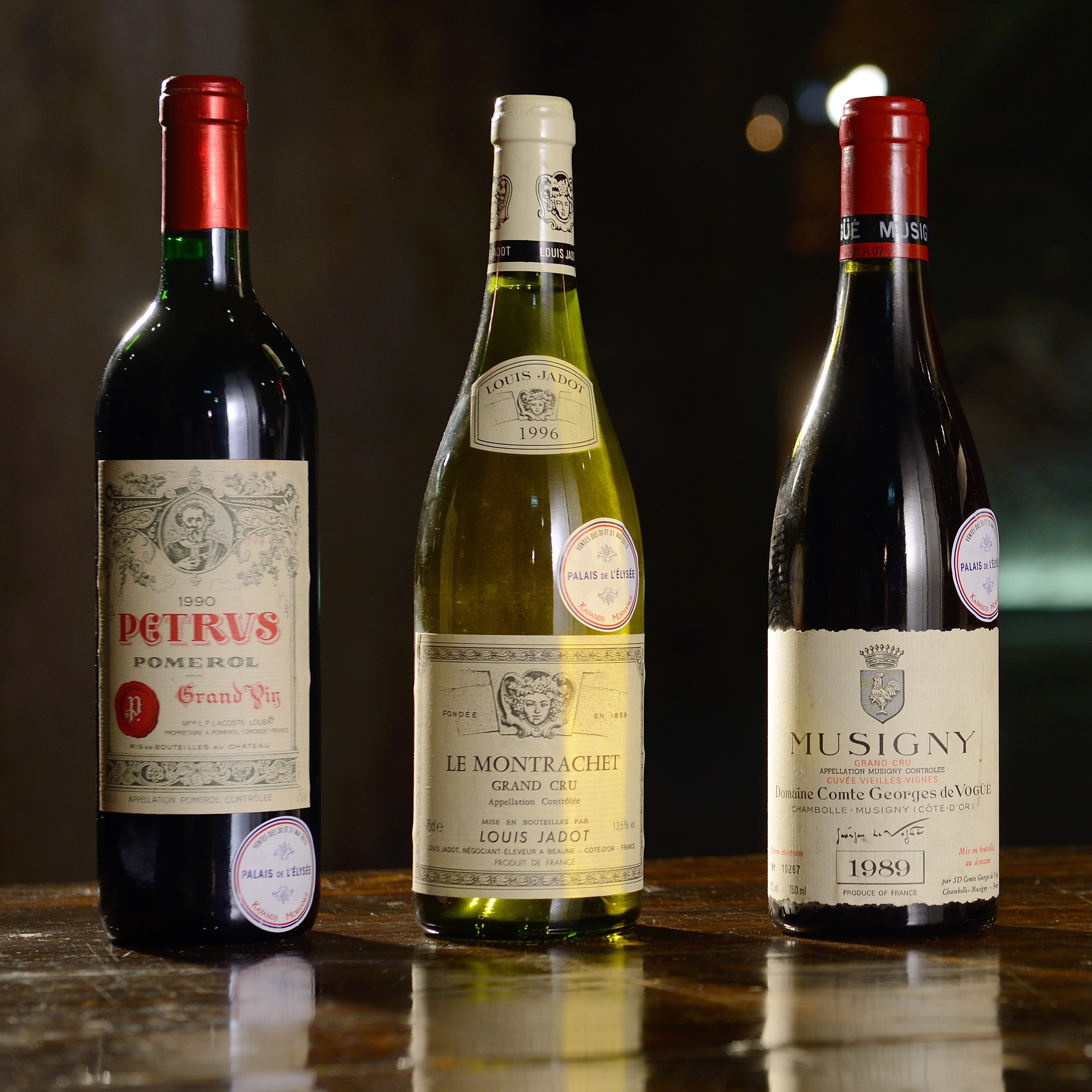 A picture taken on May 30, 2013 shows some bottles of the finest wine from the cellars of the Elysee Palace (from left), a 1990 Bordeaux's Chateau Petrus, a 1996 Le Montrachet Grand Cru, a 1989 Musigny Grand Cru, a 1985 La Romanee and a bottle of 1986 Chateau d'Yquem of 1986, to be sold during an auction in Paris.