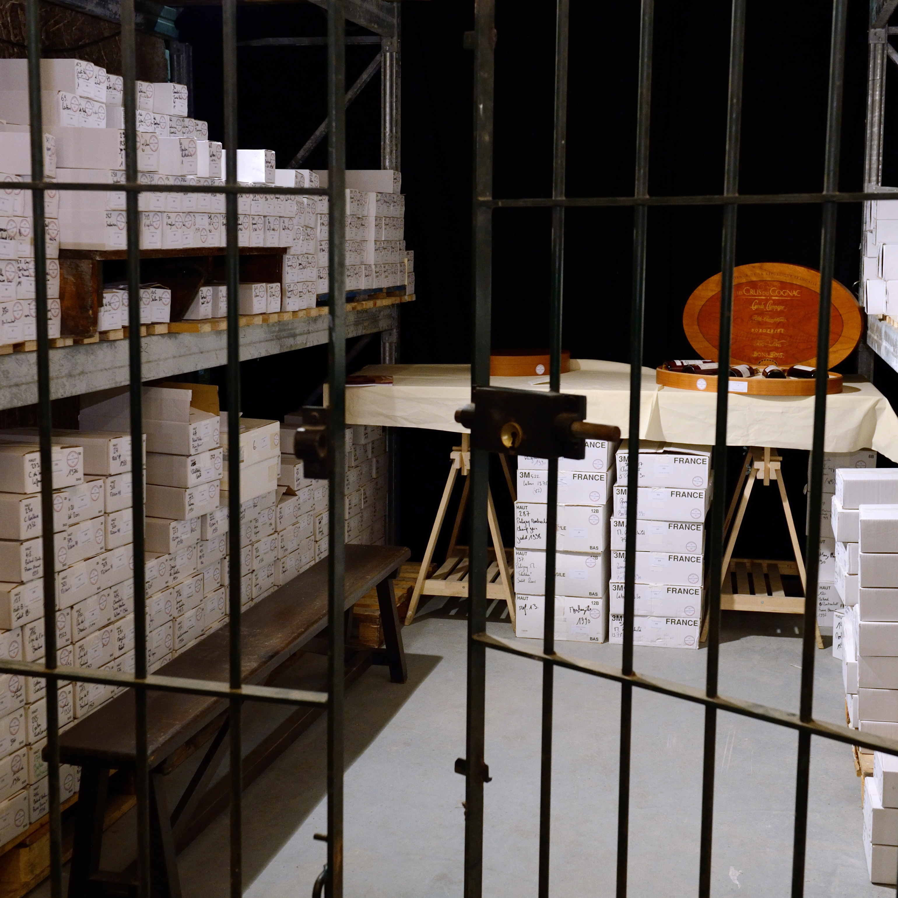 A total of 1,200 bottles from the Elysee Palace cellar, including some of the world's most prestigious labels, are stacked in Issy-les-Moulineaux prior to being sold during an auction in Paris. French President Francois Hollande has been accused of selling off France's national heritage in a sale that has become symbolic of the cash-strapped government's austerity drive.