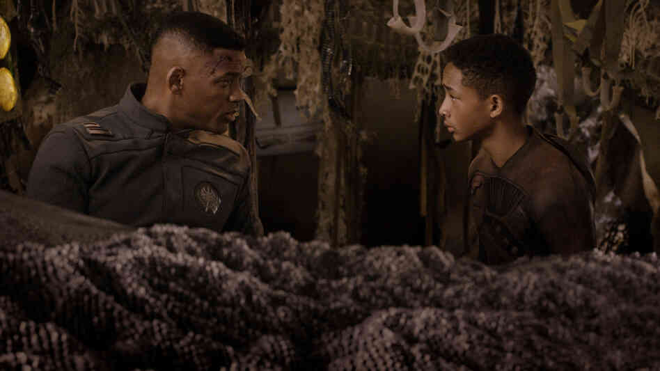 Will Smith (left) and Jaden Smith star in After Earth, an unfortunately humorless film.