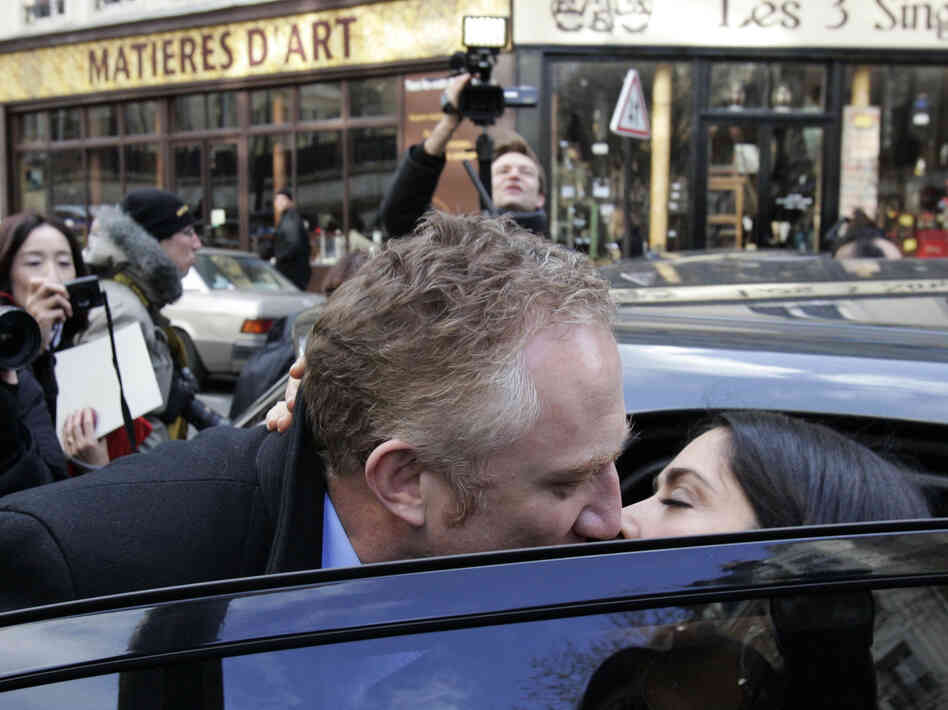 French businessman Francois-Henri Pinault kisses his wife, act