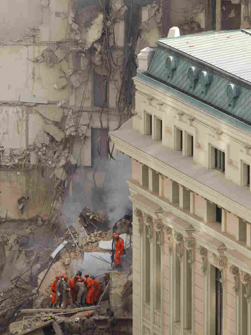 Rescue workers carry the body of a victim after a building collapsed in Rio on Jan. 26, 2012. The city's Operations Center was built to allow for a coordinated response during such emergencies.