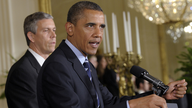 President Obama, with Education Secretary Arne Duncan at his side, calls on Congress on June 21, 2012, to stop interest rates on student loans from doubling. He is going to make that appeal again Friday. (AP)