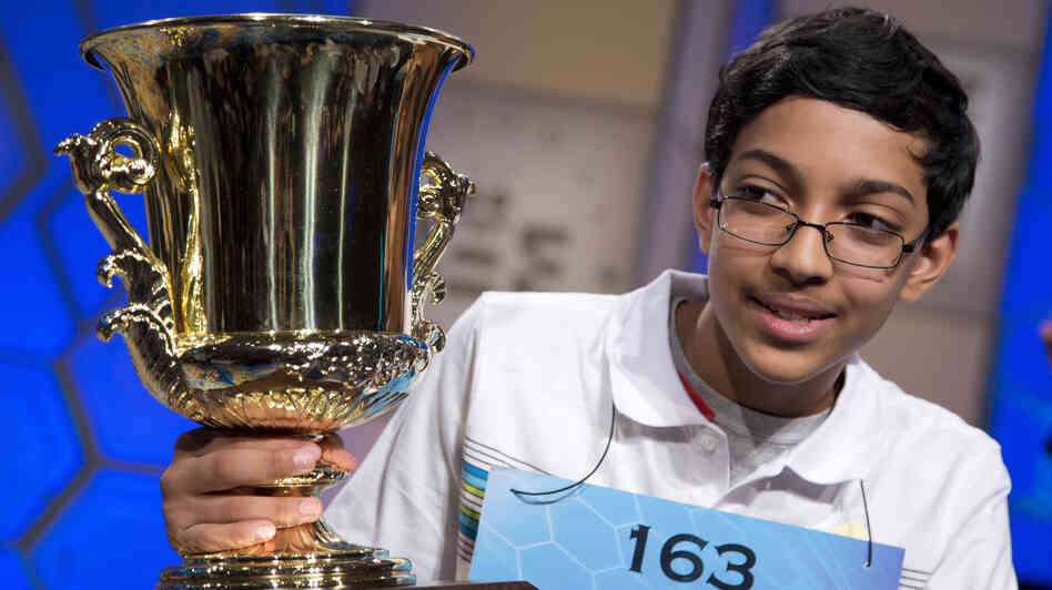 "Arvind Mahankali, 13, of Bayside Hills, N.Y., holds the championship trophy after he won the Scripps National Spelling Bee by spelling the word ""knaidel"" correctly on Thursday in Oxon Hill, Md."