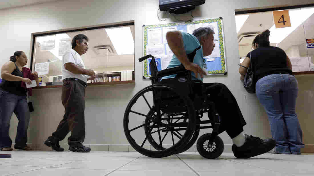 Patients wait in line at Nuestra Clinica Del Valle in San Juan, Texas, in September 2012 file photo. A study released on Wednesday finds that immigrants, particularly noncitizens, heavily subsidize Medicare, and that policies that restrict immigration may deplete Medicare's financial resources.