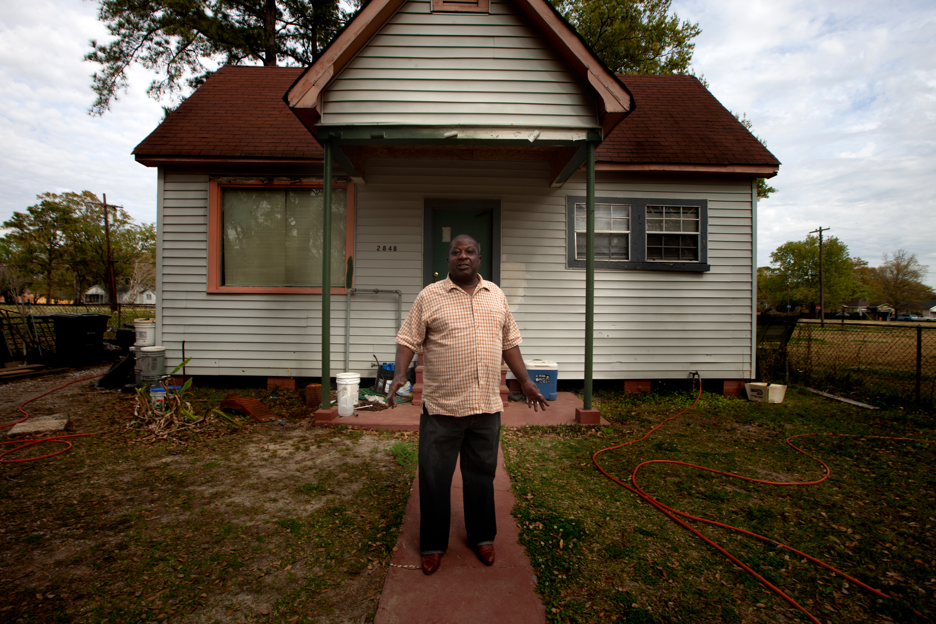 Larry Alexander lives a few hundred yards from Exxon Mobil. Many of the lots around his house are vacant because Exxon bought out his neighbors over the years.