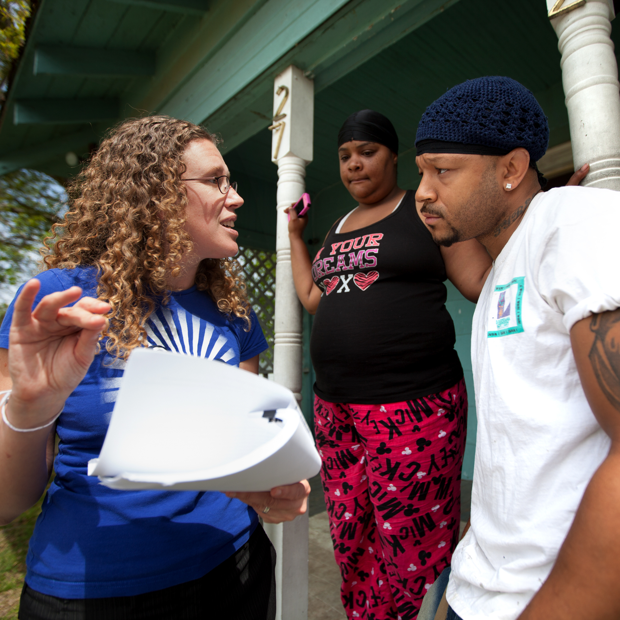Anna Hrybyk talks with Standard Heights neighborhood residents Terrica Hardnett (middle) and Terrell Sylvas (right) about the current state of the EPA's investigation into the Exxon Mobil plant.