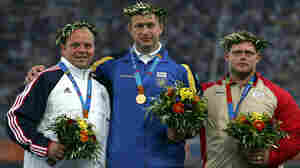 Adam Nelson (left), has been awarded the gold medal in the men's shot put, after original winner Yuriy Bilonoh of Ukraine was found to have violated doping rules.