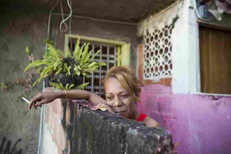Marcia Pereira looks out from her apartment in Babilonia. Babilonia and neighboring Chapeu Manguiera were once rival favelas with enemy drug gangs, but after pacification the violence has been brought under control.