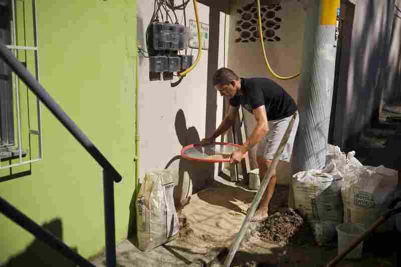 Francisco Edison Viana de Souza is building a one-bedroom apartment above his Babilonia home, which he will rent out for about 600 reals ($300).