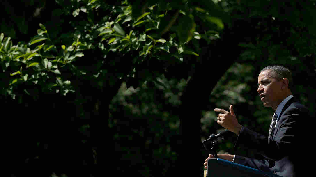 President Obama speaks in the Rose Garden of the White House on Friday. He said the economy is seeing progress but added that too many people are still struggling.