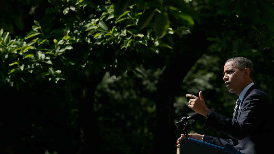 President Obama speaks in the Rose Garden of the White House on Friday. He said the economy is seein