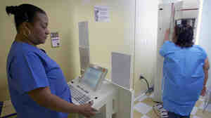 Toborcia Bedgood performs a mammogram to screen for breast cancer at the Elizabeth Center for Cancer Detection in Los Angeles in 2010.