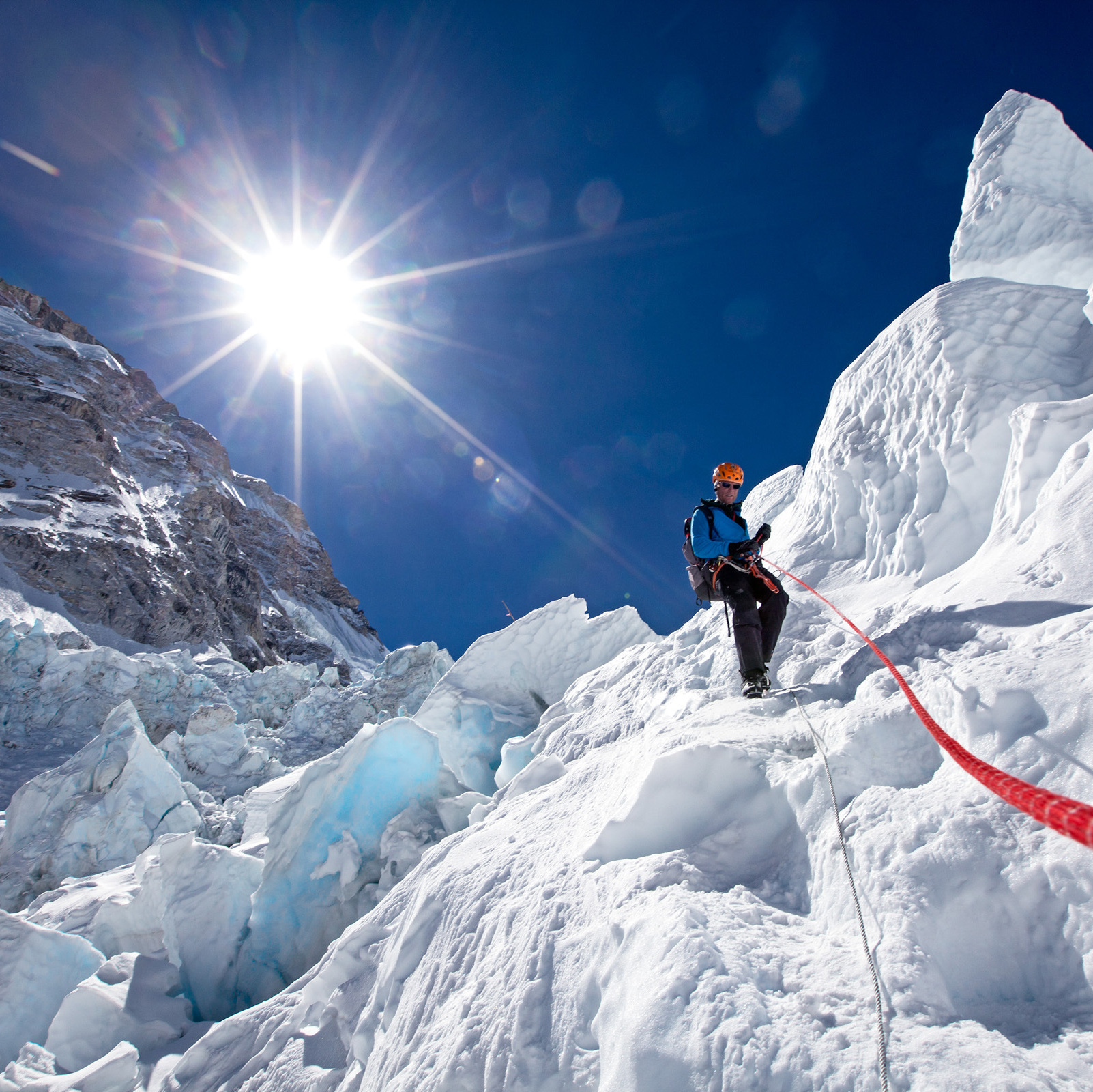 Using a fixed rope for safety, mountaineer Conrad Anker descends an ice step in the Khumbu Icefall, one of the most dangerous parts of the route to and from Everest's summit. Anker is the author of The Call Of Everest, published by National Geographic.
