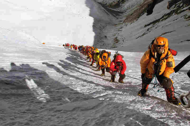 During the 2012 climbing season, long lines encumbered the ascent of the Lhotse face of Mount Everest. This photo from The Call Of Everest was taken after the photographer decided to abort his climb, due to the dangerous lines.