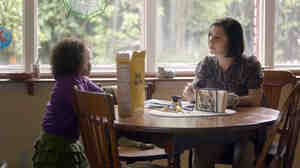 A screengrab from the Cheerios commercial showing the mom and daughter talking.