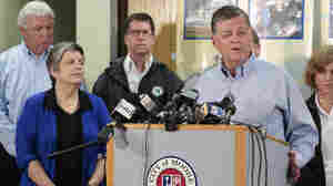 Rep. Cole speaks as U.S. Secretary of Homeland Security Janet Napolitano and others listen during a news conference in Moore last week.