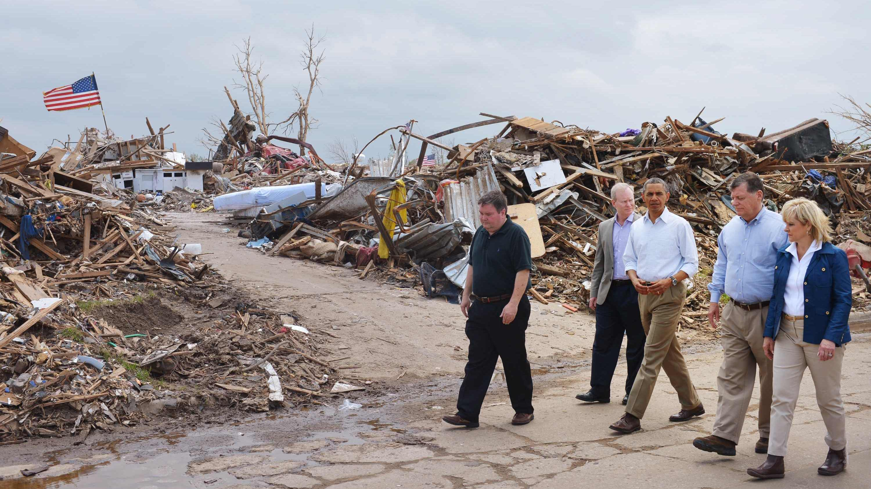 Oklahoma Rep. Tom Cole (second from right) surveys the tornado damage in Moore, Okla., on May 26 with a delegation including President Obama, Gov. Mary Fallin and Moore Mayor Glenn Lewis (far left).