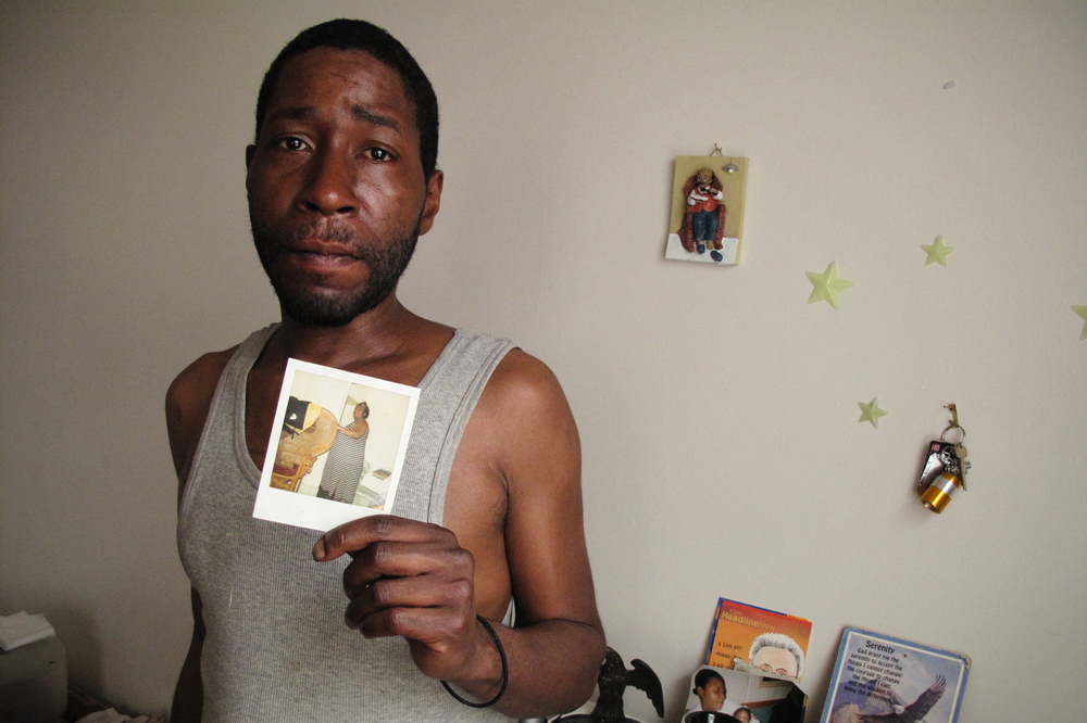 Robert Williams, 42, holds a photo of his late mother, Judy Williams.