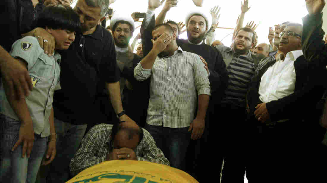 Relatives of a Lebanese Hezbollah fighter grieve at his funeral in the southern Lebanese port city of Sidon on May 22. Hezbollah fighters have been supporting the Syrian army in its battle against rebels just across the border in Qusair, Syria.