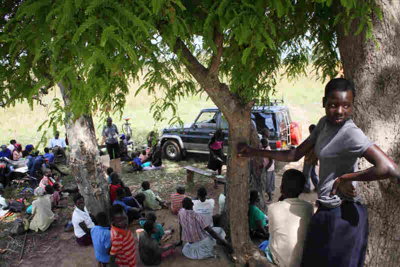 Parents and children gather at the outreach site in Pader. Twice a week, staff from the Atanga Health Center travel to various outreach sites to consult with parents and distribute a month's supply of sodium valproate.