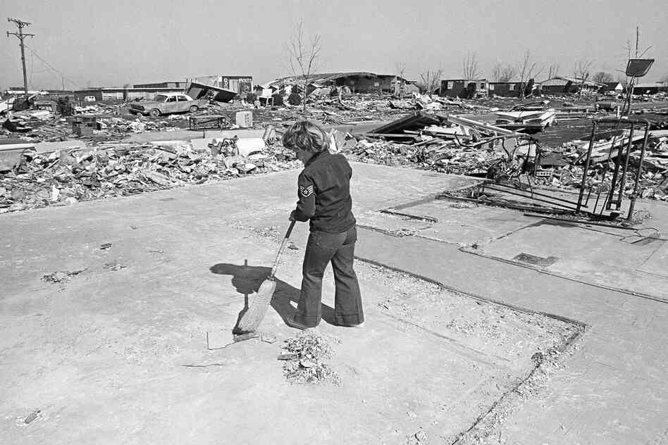 In 1974 a young xenia ohio resident sweeps the slab of a house that