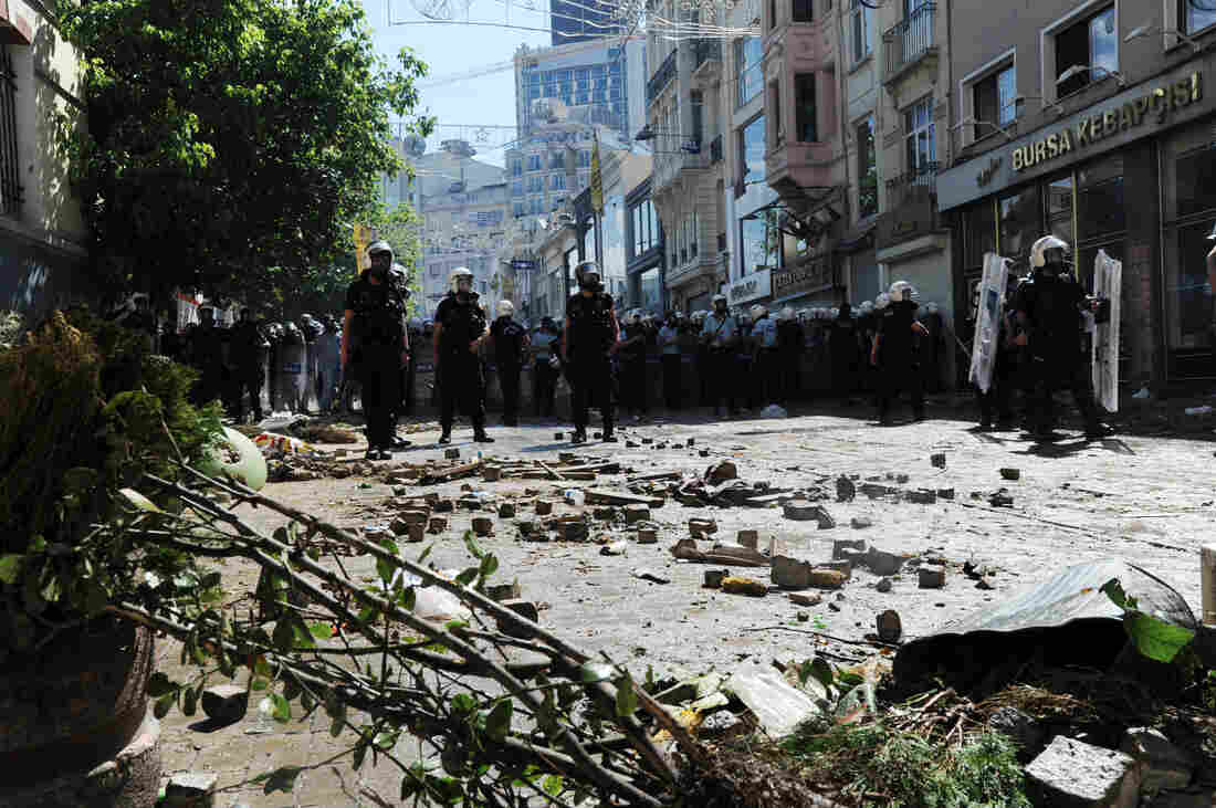 Turkish protestors and riot policemen clash on Saturday, during a protest against the demolition of Taksim Gezi Park, in Taksim Square in Istanbul.