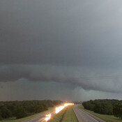 A tornado forms over I-40 in Midwest City, Okla., during rush hour on Friday.