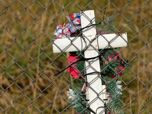 Cross on a fence