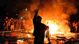 Protesters clash with riot police between Taksim and Besiktas in Istanbul, on Sunday.