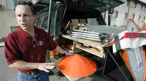 Tornado chaser Tim Samaras shows the probes he uses when trying to collect data from a tornado. This photo was taken May 26, 2006, in Ames, Iowa.