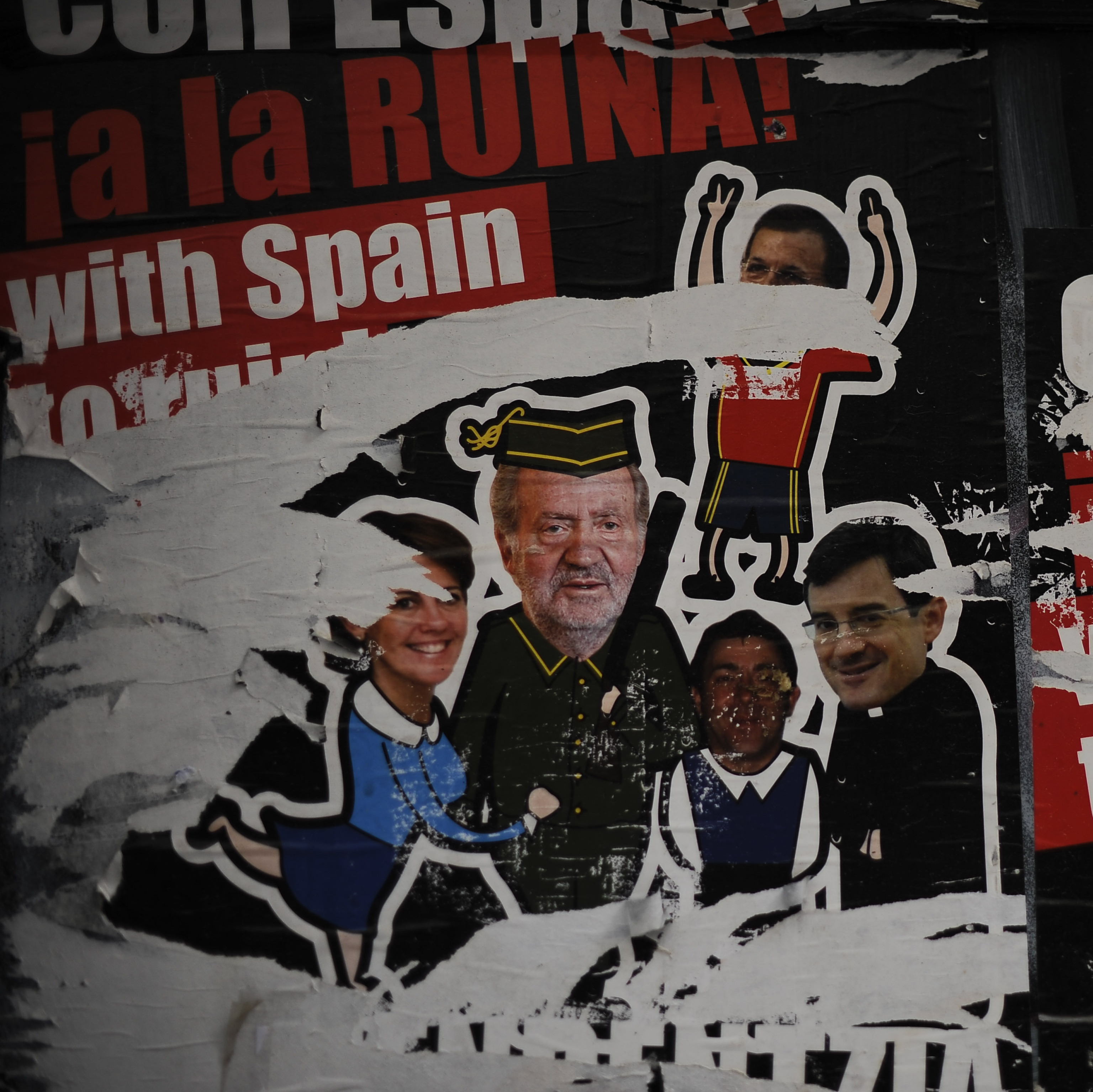"Posters against Spanish King Juan Carlos read ""With Spain to ruin"" during May Day celebrations last month in Pamplona, northern Spain."