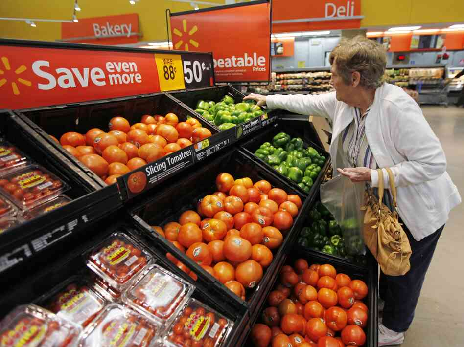 A shopper selects produce at a Wal-Mart in Deptford, N.J.