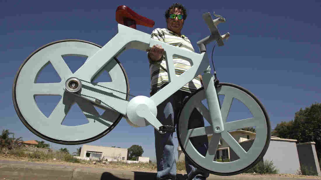 Israeli inventor Izhar Gafni and his cardboard bicycle.