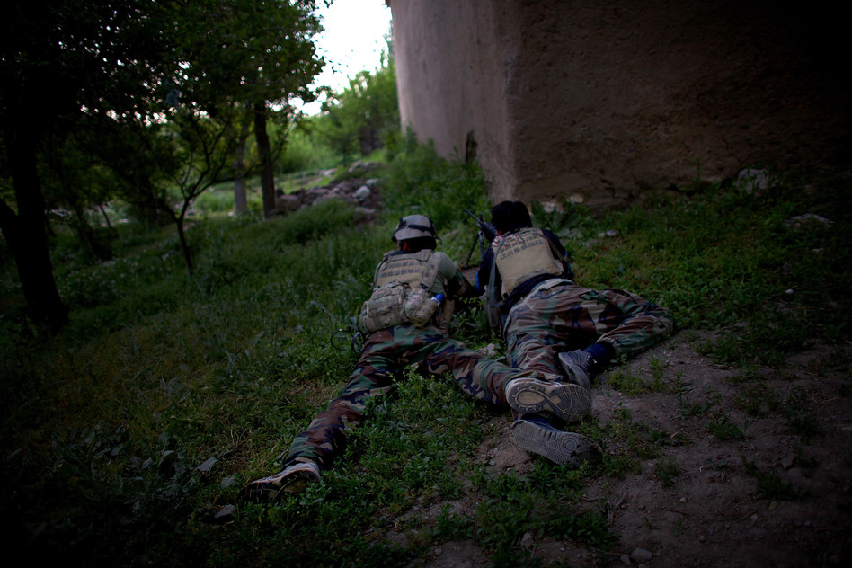 ANASF soldiers hold down a position as other members of their team patrol nearby. Taliban forces have traditionally used the area as an infiltration route and staging area because of its proximity to Kabul, which is about an hour away. (NPR )