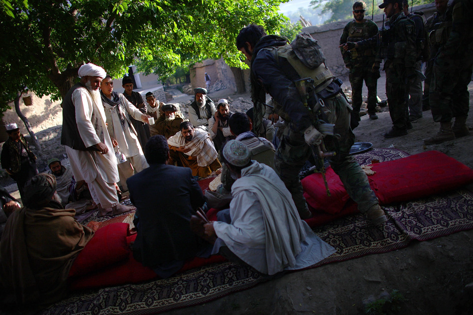 Villagers in Kasan gather to meet with Afghan local police and the Afghan National Army along with ANASF team members during a morning shura to discuss security. (NPR )